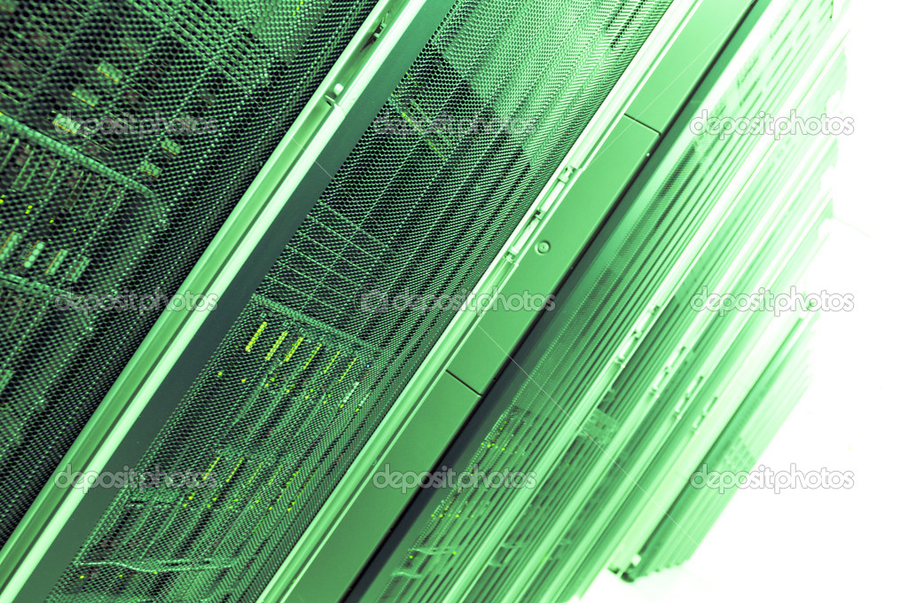 A server room with a green filter fading into a white background.  Stock Photo #11451886