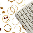 Computer and coffee stains — Stock Photo