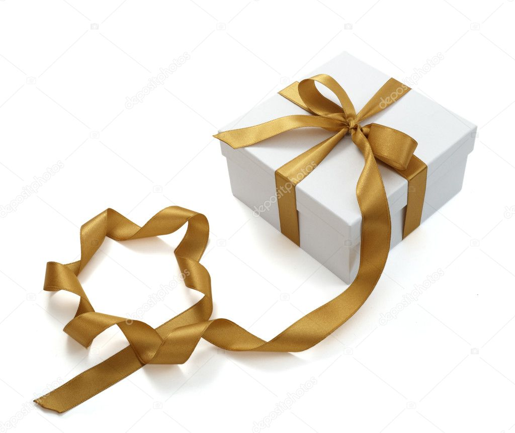 Close up of white present bow with  ribbon on white background on white background with clipping path  Stock Photo #11085734