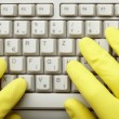 Keyboard computer digital technology hands gloves thief medicine — Stock Photo
