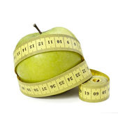 Measure tape tailor diet fitness apple fruit food length weight — Stock Photo