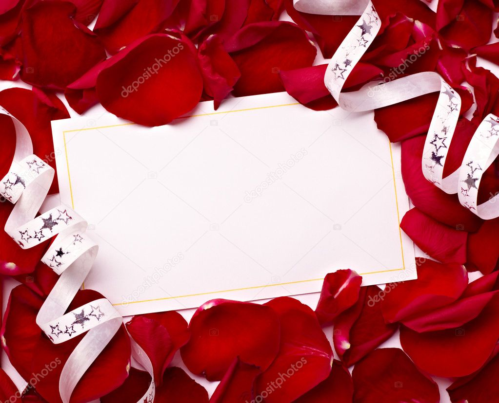 Close up of greeting card dwith rose petals decoration — Stock Photo #11409334