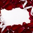 Greeting card note rose petals celebration christmas love - Stock Photo