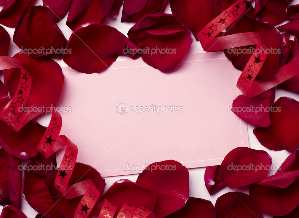 Close up of greeting card dwith rose petals decoration — Photo #11410303