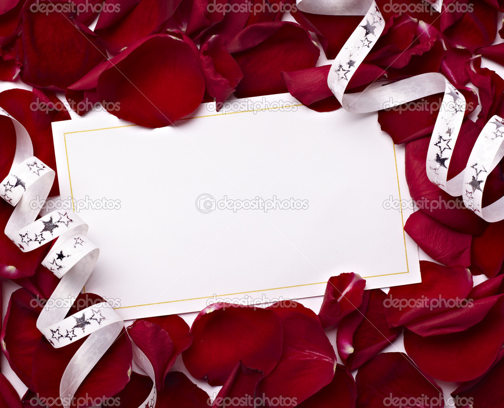 Close up of greeting card dwith rose petals decoration — Stock Photo #11410369