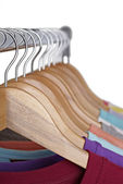 T shirts on cloth hangers — Stock Photo