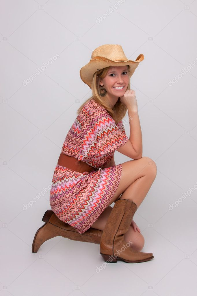 A young girl posing as a cowgirl — Stock Photo #11724490