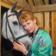 Girl in the stables — Stock Photo