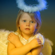 Baby girl in an angel dress — Stock Photo