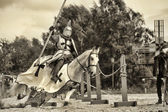 A knight riding fast horse — Stock Photo