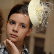 Face of young beautiful girl in a vintage hat — Stock Photo #12385816