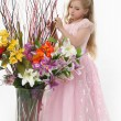 Royalty-Free Stock Photo: The girl in a pink  dress with a bouquet