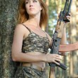 Woman with rifle — Stock fotografie