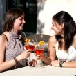 Royalty-Free Stock Photo: Two young girls while they take a cocktail