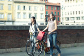 Two Girls While they make shopping in bicycle to Pisa — Stock Photo