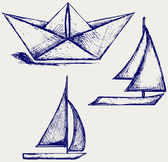 Origami paper ship and sailboat sailing — Stock Photo