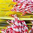 Group of white and red ropes with yellow cards — Stock Photo