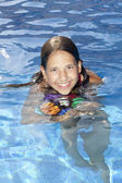 Smiling girl with ball in the swimming pool — Stock Photo