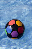 Ball of different colors is in the swimming pool — Stock fotografie