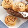Cinnamon danish bun in the basket — Foto de Stock