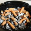 Ashtray with cigarette butts — Stock Photo #10738420