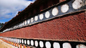 Tibetan wall in a lamasery — Stock Photo