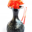 Stock Photo: Black vase with red auspicious knot