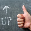 Up - word written on a blackboard with an arrow and thumb up gesture — Stock Photo #11046294