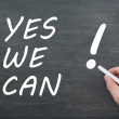 Yes we can - written with chalk on a blackboard - Stock Photo