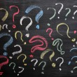 Stock Photo: Question marks on chalkboard. Decision, confusion, FAQ or other concept. Hand writing with chalk on school black board.