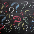 Question marks on chalkboard. Decision, confusion, FAQ or other concept. Hand writing with chalk on school black board. — Stock Photo #11432994