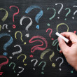 Royalty-Free Stock Photo: Question marks on chalkboard. Decision, confusion, FAQ or other concept. Hand writing with chalk on school black board.