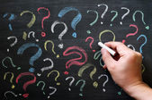 Question marks on chalkboard. Decision, confusion, FAQ or other concept. Hand writing with chalk on school black board. — Stock Photo