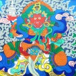 Ancient Tibetan wall painting art of buddha — Stock Photo
