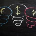 Euro, dollar and yuan symbol drawn with chalk on a blackboard — Stock Photo