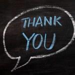 Gracias a usted por escrito en una pizarra manchada con tiza azul — Foto de Stock