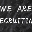Concept of we are recruiting written on smudged blackboard background — Stock Photo