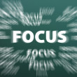 Focus word with motion rays on green chalkboard background — Stock Photo