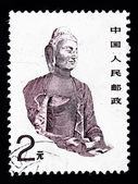 CHINA - CIRCA 1988 : A Stamp printed in China shows a buddha statue in a cave, circa 1988 — Stock Photo