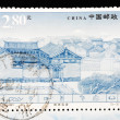 Stock Photo: CHIN- CIRC2002: Stamp printed in Chinshows famous Naxi dwellings in Lijiang Yunnan, circ2002