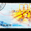 Royalty-Free Stock Photo: CHINA - CIRCA 2005: A Stamp printed in China shows West-East natural gas transmission project, circa 2005