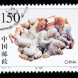 Stock Photo: CHIN- CIRC1997: Stamp printed in Chinshows stone carving art of getting drunk into innocence , circ1997