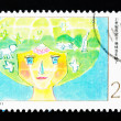 CHINA - CIRCA 2000: A Stamp printed in China shows the earth becoming younger, circa 2000 — Stock Photo