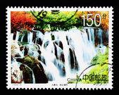 CHINA - CIRCA 1998: A Stamp printed in China shows a waterfall in Jiuzhaigou , circa 1998 — ストック写真
