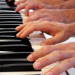 Six hands on grand piano — Stock Photo