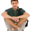 图库照片: Teenage student sitting