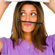 Teenage gir balancing pencil on her lip — Stock Photo