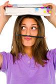 Teenage gir balancing pencil on her lip — Stock Photo