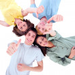 Teenagers lying down with thumbs up — Stock Photo #12040374