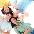 Stock Photo: Teenagers lying down with thumbs up
